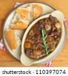 Beef bourguignon stew served with crusty bread. - stock photo