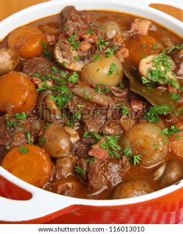 Beef bourguignon stew with shallots, mushrooms, lardons and carrots. - stock photo