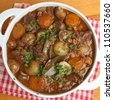Beef bourguignon, traditional French stew, in casserole dish. - stock photo