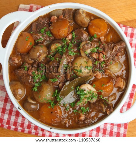 Beef bourguignon, traditional French stew, in casserole dish. - stock ...