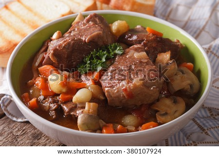 Beef Bourguignon with mushrooms close up in a bowl on the table. horizontal - stock photo