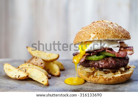 Beef burger with bacon and egg