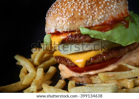 beef burger with grilled bacon burger beef with potatoes  American junk fast food hamburger with cheese cheeseburger - stock photo