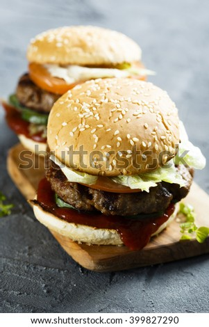 Beef burgers on desk - stock photo