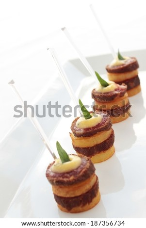 beef canapes on platter - stock photo