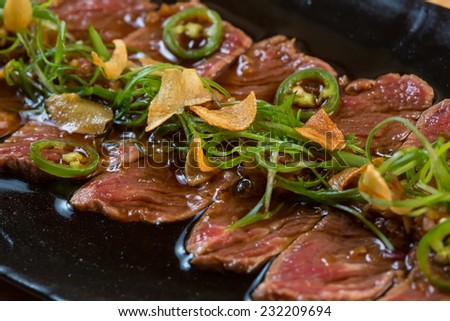 Beef Carpaccio on dark background. selective focus - stock photo
