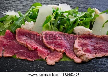 beef carpaccio on slate - stock photo