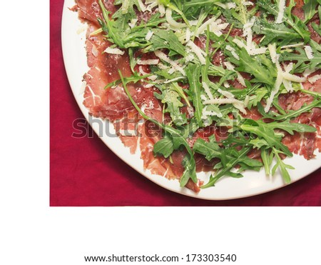 Beef carpaccio white plate red napkin , isolated - stock photo