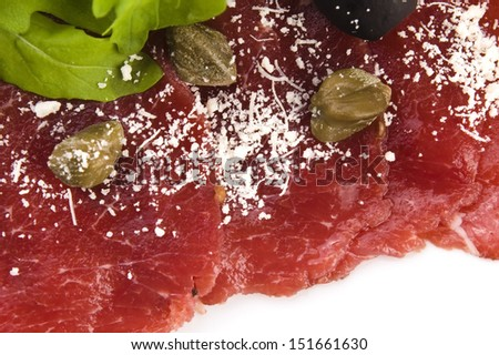Beef carpaccio with rucola and parmesan  - stock photo