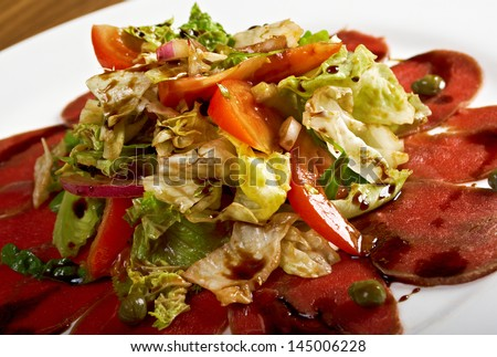 Beef carpaccio with vegetable.shallow DOF - stock photo