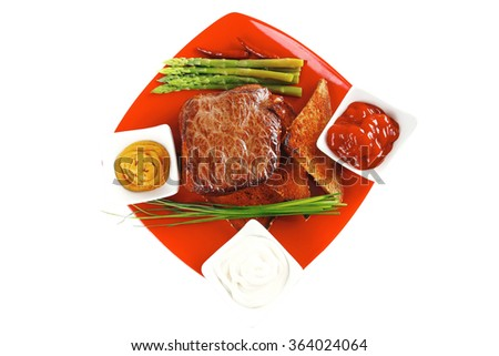 beef chunk on red dish with seasoning - stock photo