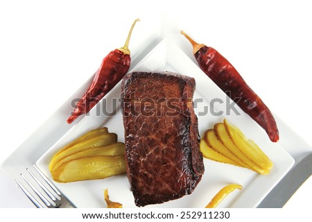 beef chunk with peppers on white plate - stock photo