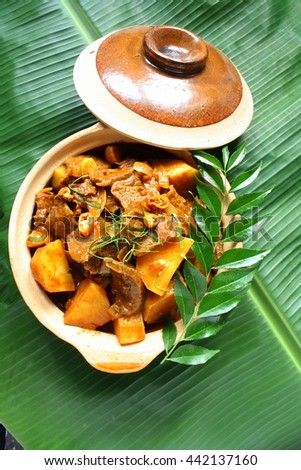 Beef curry with potatoes on banana leaf - stock photo