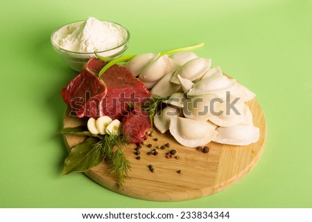 Beef, garlic, dumplings - stock photo