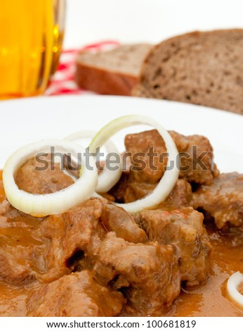 Beef Goulash on White Plate, Bread and Beer