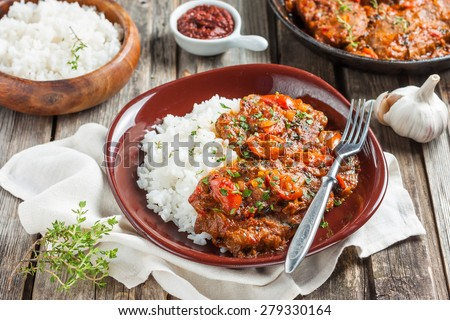 beef in a spicy tomato sauce with rice - stock photo