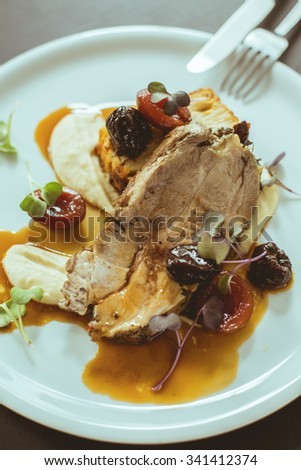 Beef in plum sauce on white table - stock photo