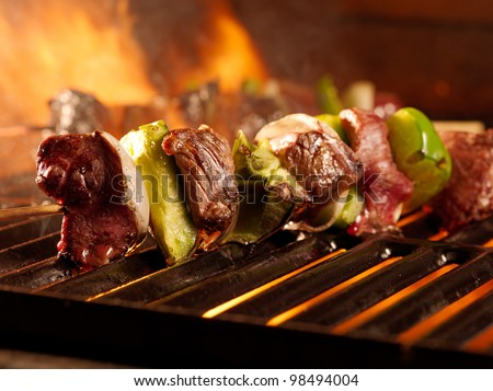 beef kababs on the grill closeup - stock photo