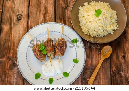 Beef kebab with coriander, garlic, couscous and mint dip - stock photo