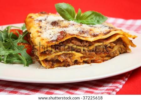 Beef lasagna served with rocket salad - stock photo