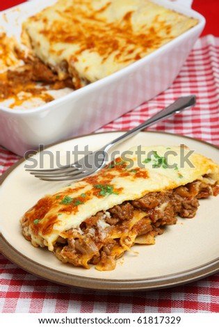 Beef lasagna. (Shallow DoF, focus on corner of lasagna)