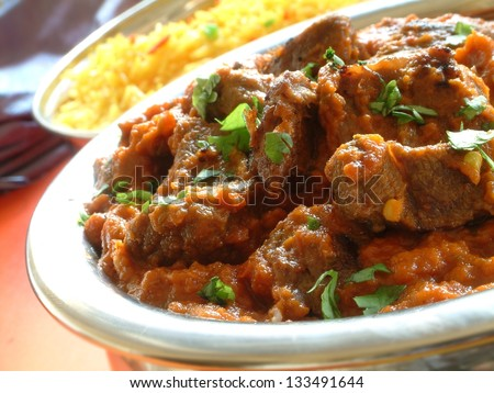 beef madras with pilau rice - stock photo