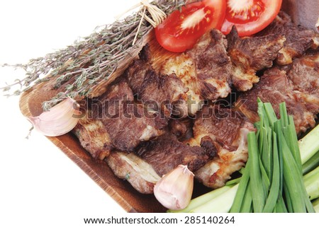 beef meat grilled ribs with asparagus and tomatoes isolated over white background - stock photo