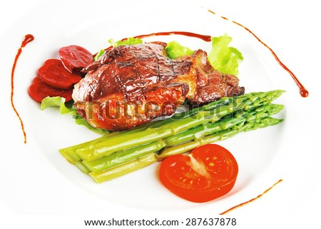beef meat served on white plate with asparagus
