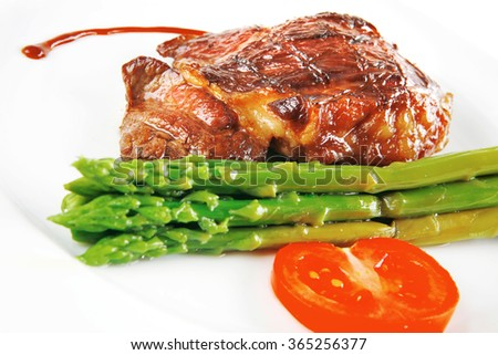 beef meat served with asparagus on white dish