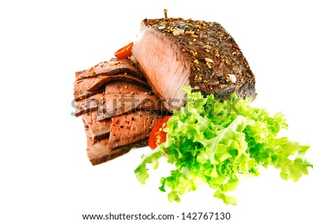 beef meat slice served with vegetables on white - stock photo