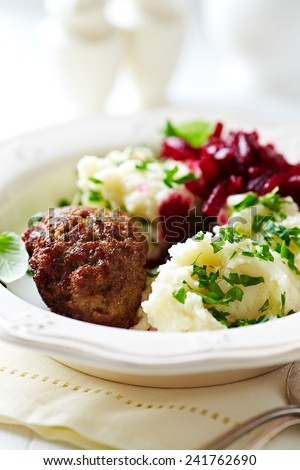 Beef meatball with mashed potatoes and beetroot salad - stock photo