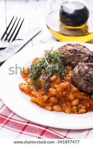 beef meatballs and bean stew in tomato sauce