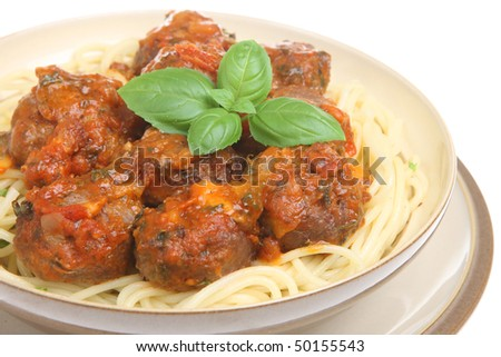 Beef meatballs in bolognese sauce with spaghetti - stock photo