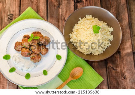 Beef meatballs with cilantro, garlic, couscous and mint dip - stock photo