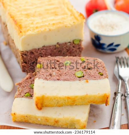 Beef Meatloaf with Green Peas Topped with Cheesy Mashed Potato, close up, square - stock photo