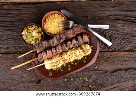 Beef, Mozzarella and Chicken Hearts Kebabs - stock photo