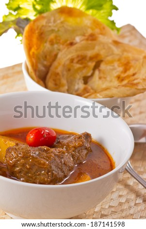 Beef Mussaman Curry and puff. - stock photo