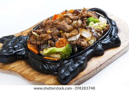 Beef on a hot plate in a Chinese style - stock photo