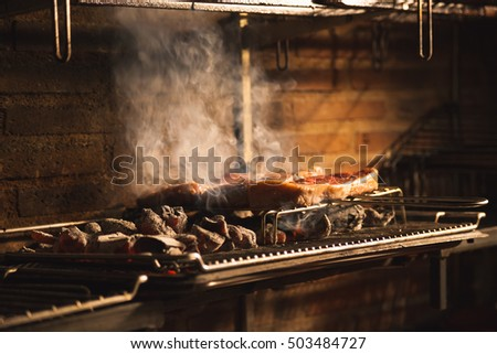 beef on barbecue restaurant with red-hot coals