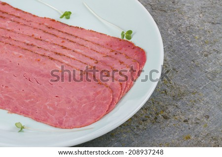 Beef Pastrami on a Slate Board - stock photo