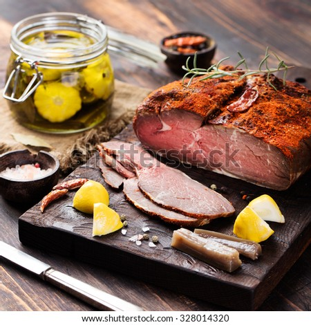 Beef pastrami sliced, roast beef , slow cooking  with marinated in olive oils eggplants and scallops on wooden board,Turkish cuisine           - stock photo
