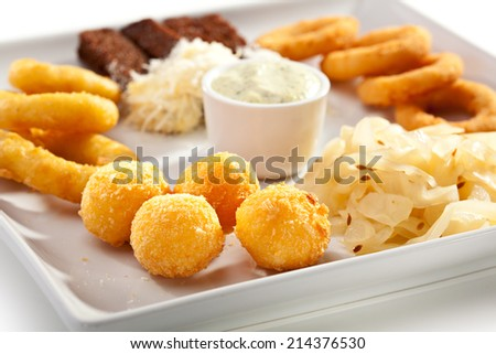 Beef Plate - Garlic Toasts with Parmesan Cheese, Cheese Balls and Calamari Rings. Garnished with Tartar Sauce - stock photo