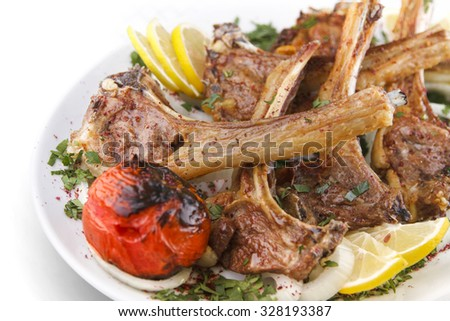 Beef rib barbeque with lemon and grilled tomato