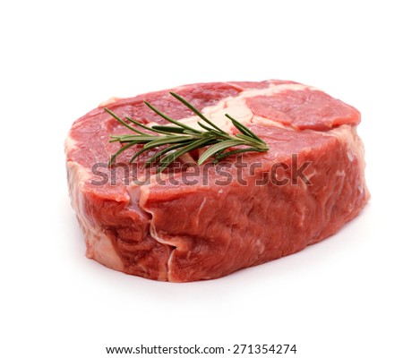 Beef ribeye steak garnished with sprig of rosemary, isolated - stock photo
