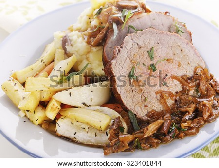 Beef Roast with Mashed Potatoes and Root Vegetables - stock photo