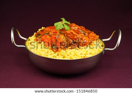 Beef Rogan Josh a popular indian curry with red pepper and spinach - stock photo