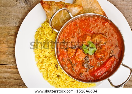 Beef Rogan Josh a popular indian curry with red pepper and spinach top view - stock photo