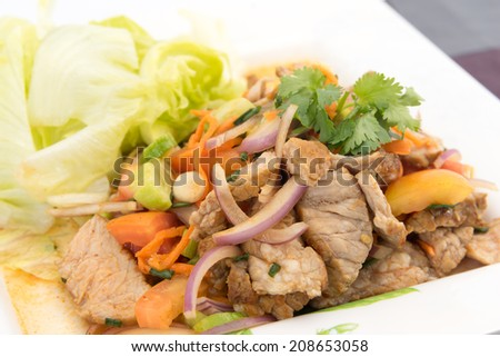 "Beef Salad with juicy dressing, thai call ""Yum Neua"", lightly grilled juicy beef in a dressing tossed with red onions, green onions, cilantro, cucumber, tomatoes, fresh chili and slice lettuce"