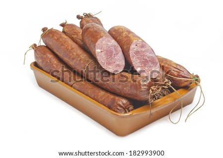 beef sausage on a plate - stock photo