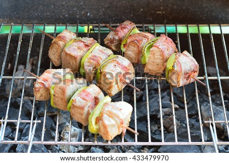 Beef shish kebab skewers on the grill closeup - stock photo